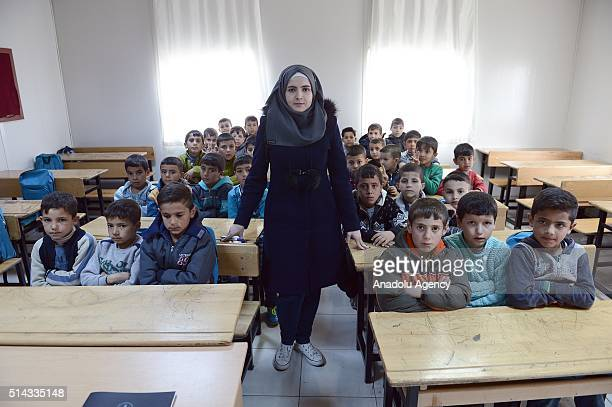 Syrian refugee female teacher instructs refugee students fled from civil war in Syria at a class located in a refugee facility in Malatya Turkey on...