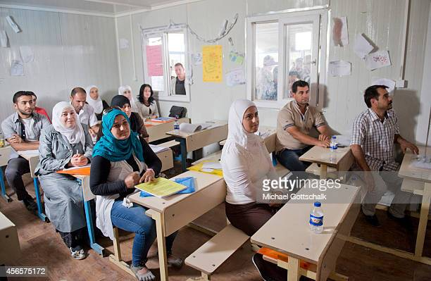 Syrian refugee female teachers take part in further education programme of unicef in a unicef school in refugee camp Kawergosk for syrian refugees in...