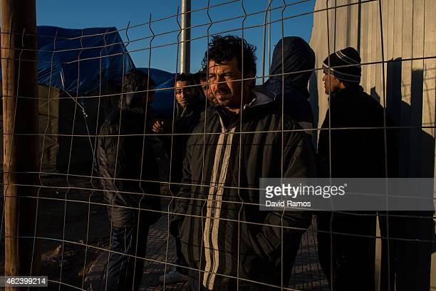 Syrian refugee from Kobani looks through the fence at the Temporary Inmigrant Centre on January 22 2015 in Melilla Spain According to Spanish Police...
