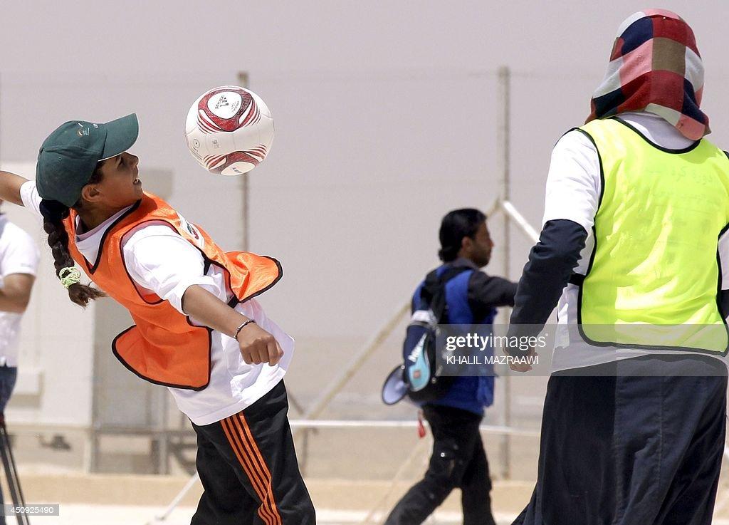 JORDAN-THEME-FOOTBALL-SYRIA-REFUGEE-DAY : News Photo