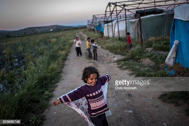 Syrian refugee girl plays outside her home at a tent camp on the outskirts of Izmir on April 27 2016 in Izmir Turkey For many Syrian refugees living...