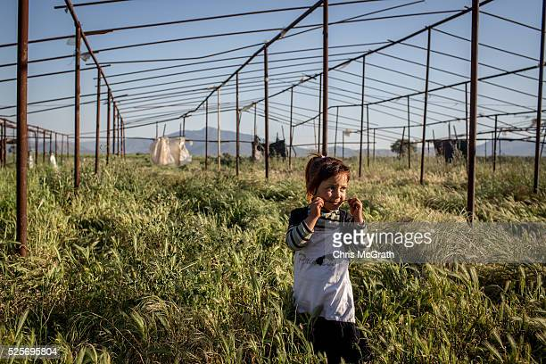 Syrian refugee girl plays outside her home at a tent camp on the outskirts of Izmir on April 28 2016 in Izmir Turkey For many Syrian refugees living...