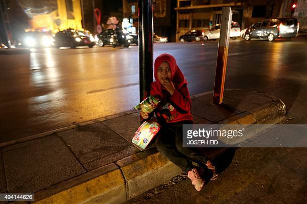 Syrian refugee girl sells tissue paper on a busy intersection in the Lebanese capital Beirut late on October 24 2015 At least 1510 children...