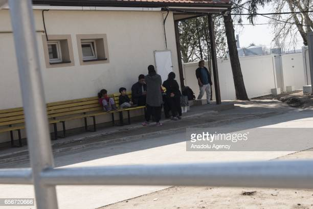 Syrian refugee halted by government as they were trying to cross Hungary with other asylum seekers wait at a building at the Kelebija border crossing...