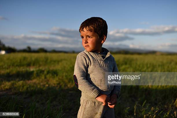 A Syrian refugee kid stands in a field just next to Idomeni refugee camp on May 5'th 2016 Thousands of migrants are still located in the makeshift...