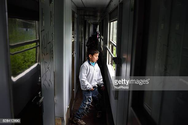 A Syrian refugee kid stands in a train wagon used for his family accomodation at Idomeni refugee camp on May 4'th 2016 Humanitarian conditions in the...