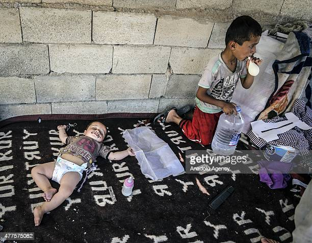 Syrian refugee kid who fled clashes in the Syrian town of Tal Abyad with his family sleeps while waiting at Akcakale Border gate to return to Syria...