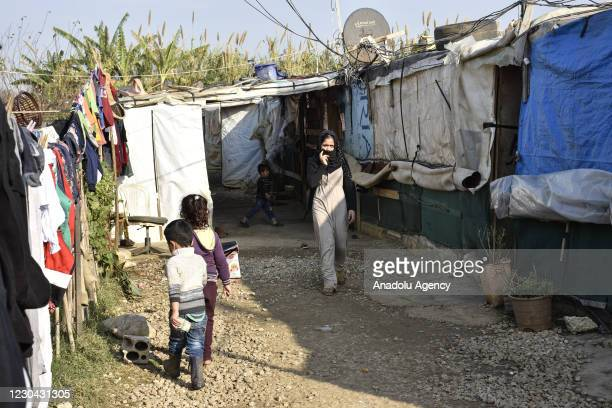 Syrian refugee kids are seen in a refugee camp after their tent camp was set on fire in clashes between a group of Lebanese and Syrian refugees in...