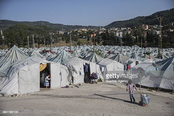 Syrian refugee kids fled from their homes due to civil war in their homeland are seen in Yayladagi YIBO camp in Hatay province of Turkey on October...