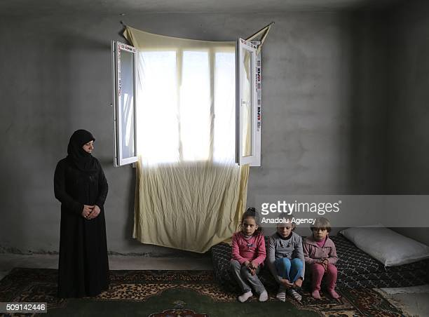 Syrian refugee Necat Said , fled from Syria due to ongoing civil-war, poses with her nieces at a house in Turkey's Syrian border city Hatay's...