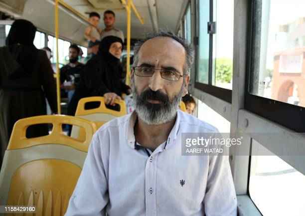 Syrian refugee Nidal Hussein Hussein one of those suddenly deported from Turkey rides in a bus transporting him through the Bab alHawa crossing...