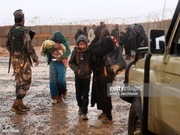 Syrian refugee patients from the makeshift Rukban camp which lies in noman'sland off the border between Syria and Jordan in the remote northeast...