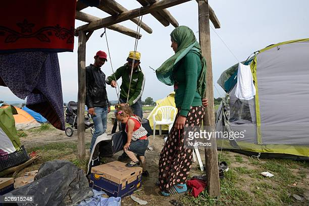 A Syrian refugee prepares a swing for his children on May 1'st 2016 in Idomeni refugee camp Humanitarian conditions in the camp are deteriorating as...