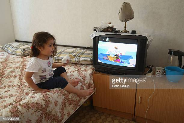 Syrian refugee Ranim Zayat who is nearly 3 watches television in the one room she shares with her parents Mohamed and Laloosh at an asylumseekers'...