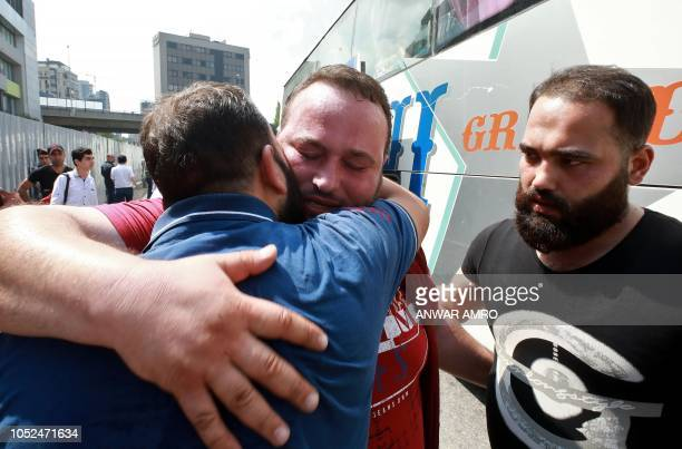 Syrian refugee Rawad Kurdi bids farewell before boarding a bus on September 17 2018 as they return to Syrian after living as refugees in Lebanon for...