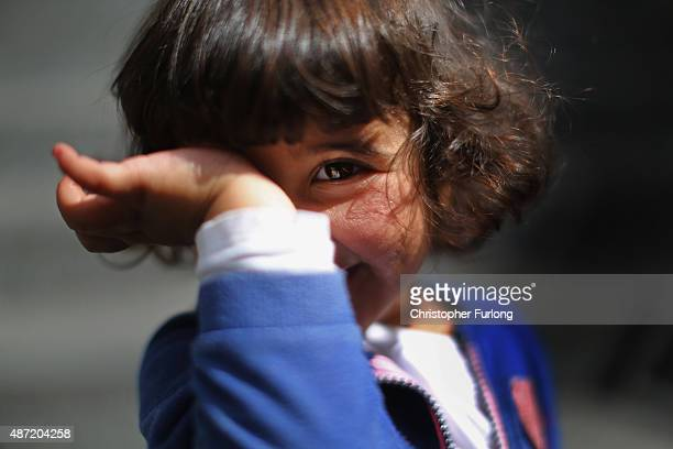 Syrian refugee Sara Albree aged three waits with her family for a train to Vienna at Keleti station on September 7 2015 in Budapest Hungary As the...