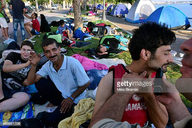 Syrian refugee shaves after sleeping on the street after crossing part of the Aegean sea from Turkey to Greece on a dinghy on August 14 2015 in Kos...