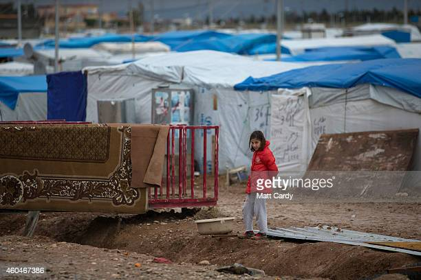 Syrian refugee stands beside a bridge over a drainage ditch at the Qushtapa Refugee Camp, on December 14, 2014 in Erbil, Iraq. Although the...