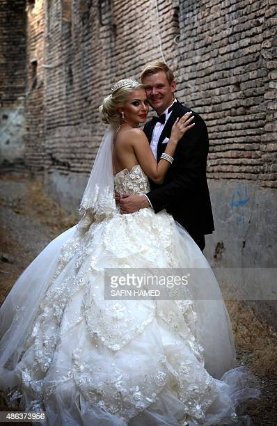 Syrian refugee Ster Hakim and her husband German Carsten Schroder pose for a wedding photo at the Arbil Citadel in the capital of the autonomous...