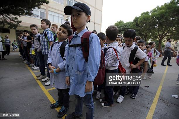 Syrian refugee students attend the first day of school in Lebanon's northern port city of Tripoli on October 18 2015 Lebanon a country of four...