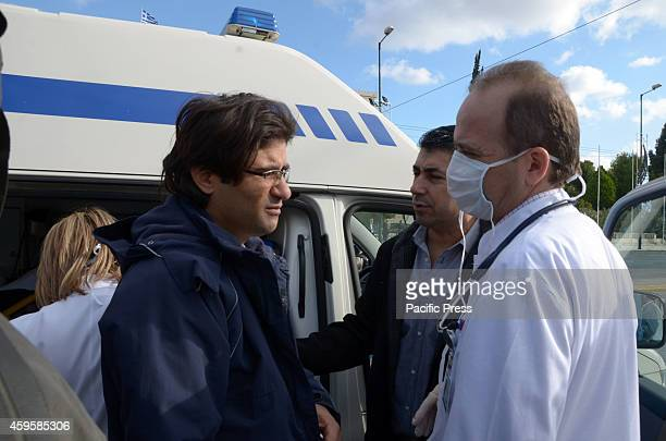 Syrian refugee talks with a doctor about his health. Syrian refugees that live in Greece stay on Syntagma square for 7 days and are on the second day...