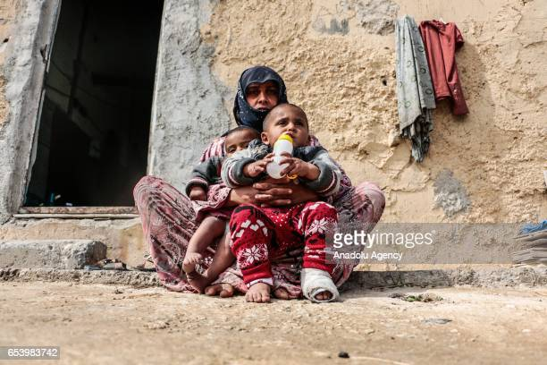 Syrian refugee widow 25yearsold Hawla Shafi fled from Syria's Raqqa city due to ongoing civilwar is seen with her kids in front of an abandoned...