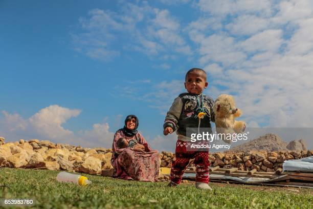 Syrian refugee widow 25yearsold Hawla Shafi fled from Syria's Raqqa city due to ongoing civilwar is seen with her kids near an abandoned electric...