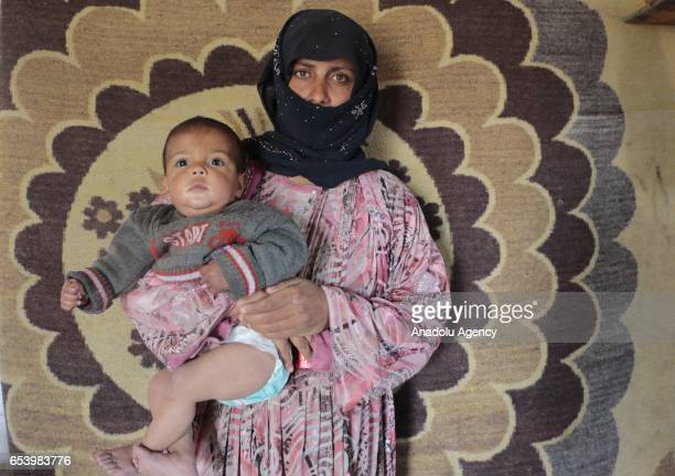 Syrian refugee widow 25yearsold Hawla Shafi fled from Syria's Raqqa city due to ongoing civilwar is seen with her kids inside an abandoned electric...