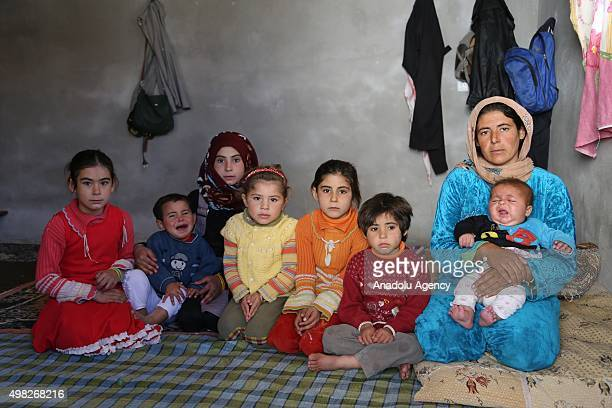 Syrian refugee woman fled from her home due to civil war is seen with her children at a house in Reyhanli district of Hatay on November 22 2015...