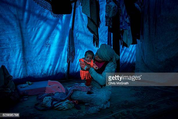 Syrian refugee woman looks after her two month old baby in her home at a tent camp on the outskirts of Izmir on April 28 2016 in Izmir Turkey For...