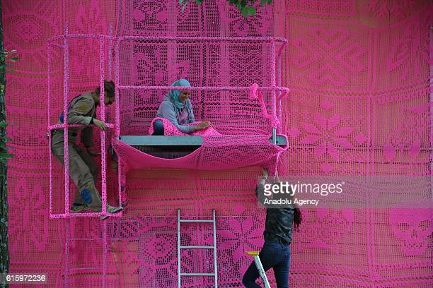Syrian refugee women take part in a project of decorating a home filled with crochet in Avesta Sweden on August 6 2016 Syrian refugee women take part...
