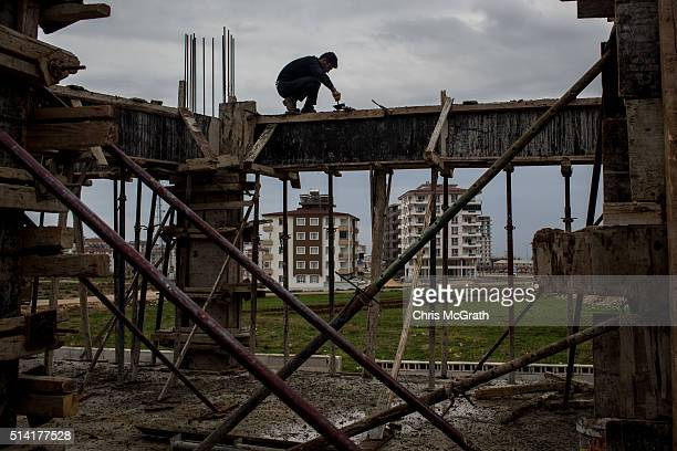Syrian refugee works on a construction site on March 3, 2016 in Kilis, Turkey. Kilis a city located just 10km from the Syrian border and the location...