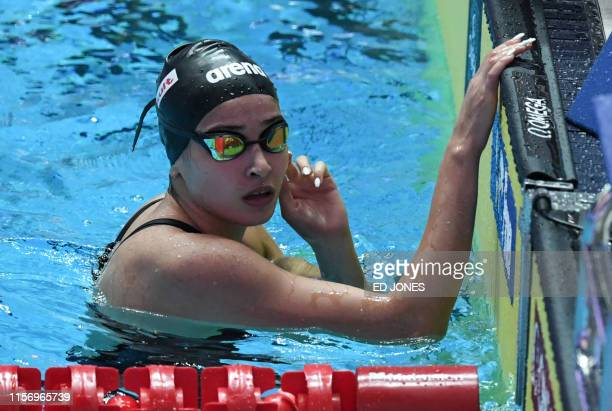 Syrian refugee Yusra Mardini reacts after competing in a heat for the women's 100m butterfly event during the swimming competition at the 2019 World...