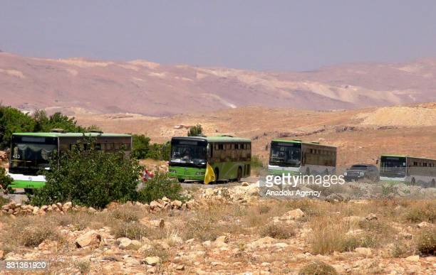 Syrian refugees and members of Ahrar alSham connected with Free Syrian Army are seen on the way back their home country with buses and vehicles after...