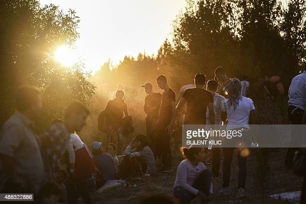Syrian refugees and migrants gather near the highway on September 15 on their way to the border between Turkey and Bulgaria in the northwestern...