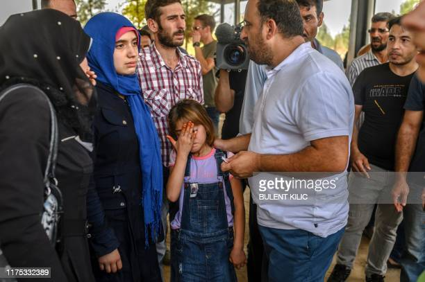 Syrian refugees and sister of ninemonthold baby Mohammed Omar killed in a mortar attack a day earlier in Akcakale near northern Syria mourns after...