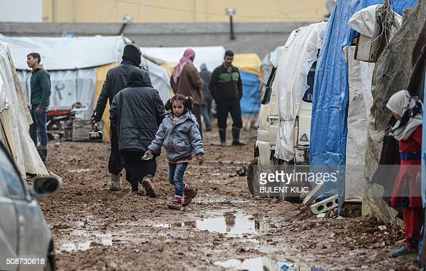 Syrian refugees are pictured in a camp as Syrians fleeing the northern embattled city of Aleppo wait on February 6 2016 in Bab alSalama near the city...