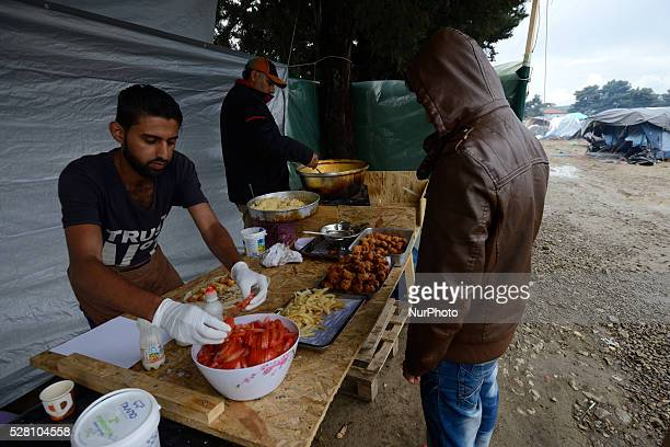 Syrian Refugees are preparing falafel in a food stand at Idomeni refugee camp on May 3'rd 2016 Humanitarian conditions in the camp are deteriorating...