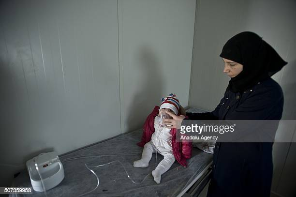 Syrian refugees are seen at a health center at Elbeyli accommodation facility in Kilis Turkey on January 29 2016 Hosting nearly 25 million Syrian...