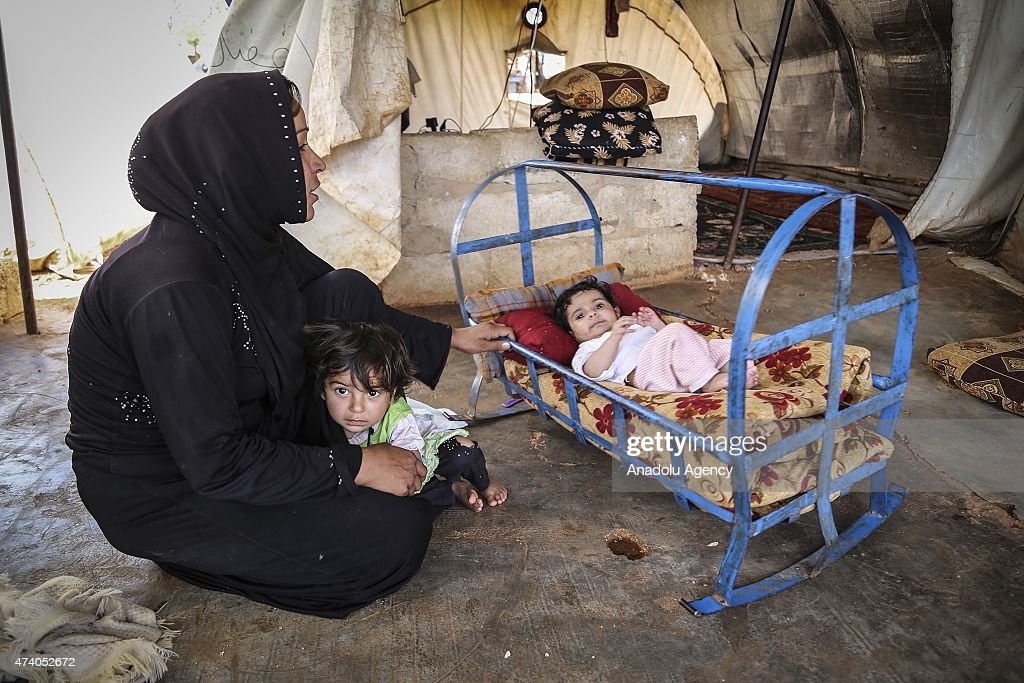 Syrian refugees are seen at Atmeh refugee camp in Idlib, Syria on May 19, 2015. More than 60 thousand refugees, fled their homes due to the attacks of Assad's forces, try to hold on life under harsh living conditions at the Atmeh refugee camp in Idlib, Syria.