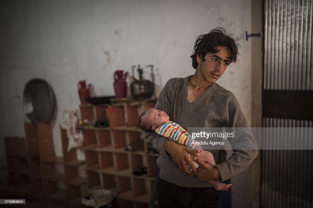 Syrian refugees are seen at Atmeh refugee camp in Idlib, Syria on May 21, 2015. More than 60 thousand refugees, fled their homes due to the attacks of Assad's forces, try to hold on life under harsh living conditions at the Atmeh refugee camp in Idlib, Syria.