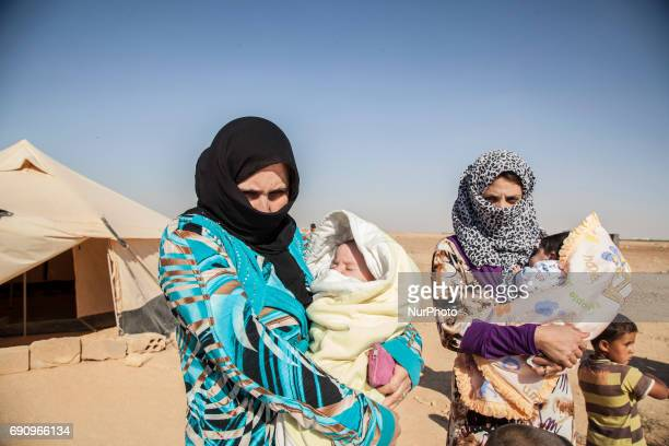 Syrian refugees are seen at the Zaatari refugee camp on the Jordanian border on 31 May 2017 It's the second refugee camp in the world The field of...
