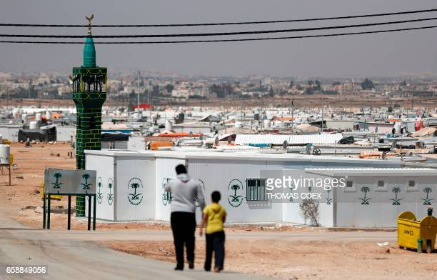 Syrian refugees are seen at Zaatari camp which shelters some 80000 Syrian refugees on the Jordanian border with warravaged Syria on March 28 2017...