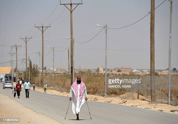 Syrian refugees are seen on a road at Zaatari refugee camp on July 18 2013 near the Jordanian city of Mafraq some 8 kilometers from the...