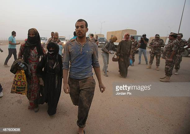 Syrian refugees arrive at the area of AlRoqban in the desert northeast Jordan at the border with both Syria and Iraq on September 10 580km away from...