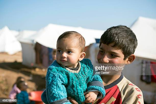syrian refugees at displaced persons camp - humanitarian aid stock pictures, royalty-free photos & images