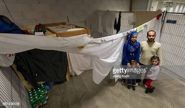 Syrian refugees Chalid Al Shaer and his family show their private area inside an emergency accommodation for refugees in the MoebelHoeffnerBuilding...