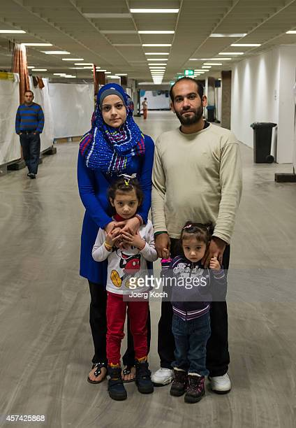 Syrian refugees Chalid Al Shaer and his family stand inside an emergency accommodation for refugees in the MoebelHoeffnerBuilding a former furniture...