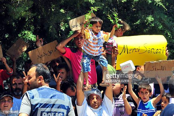 Syrian refugees chant slogans during a demonstration at the Turkish Red Crescent camp in the Altinozu district of Hatay some 30 kms from the Syrian...