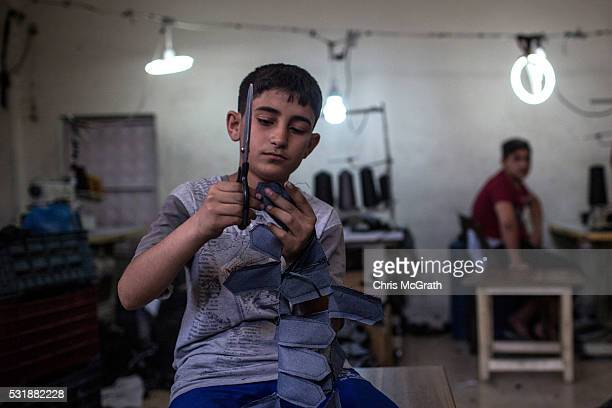 Syrian refugees child works in a Syrian owned clothing factory on May 17 2016 in Gaziantep Turkey Since fleeing the war and after the new EU Turkey...